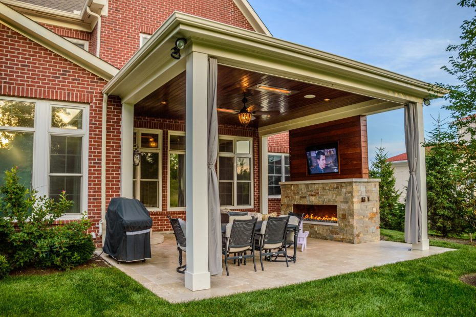 Outdoor Living Space With Covered Patio And Fireplace In Mason Oh
