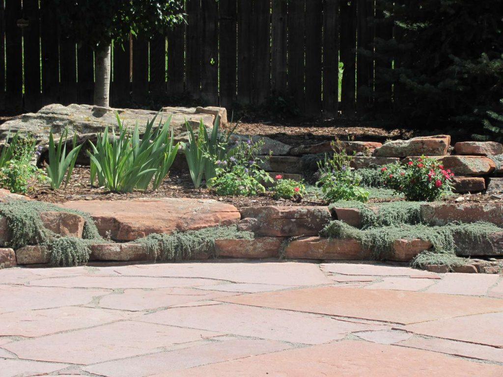 Patio With Moss Rock Wall And Thyme Glacier View Landscape And