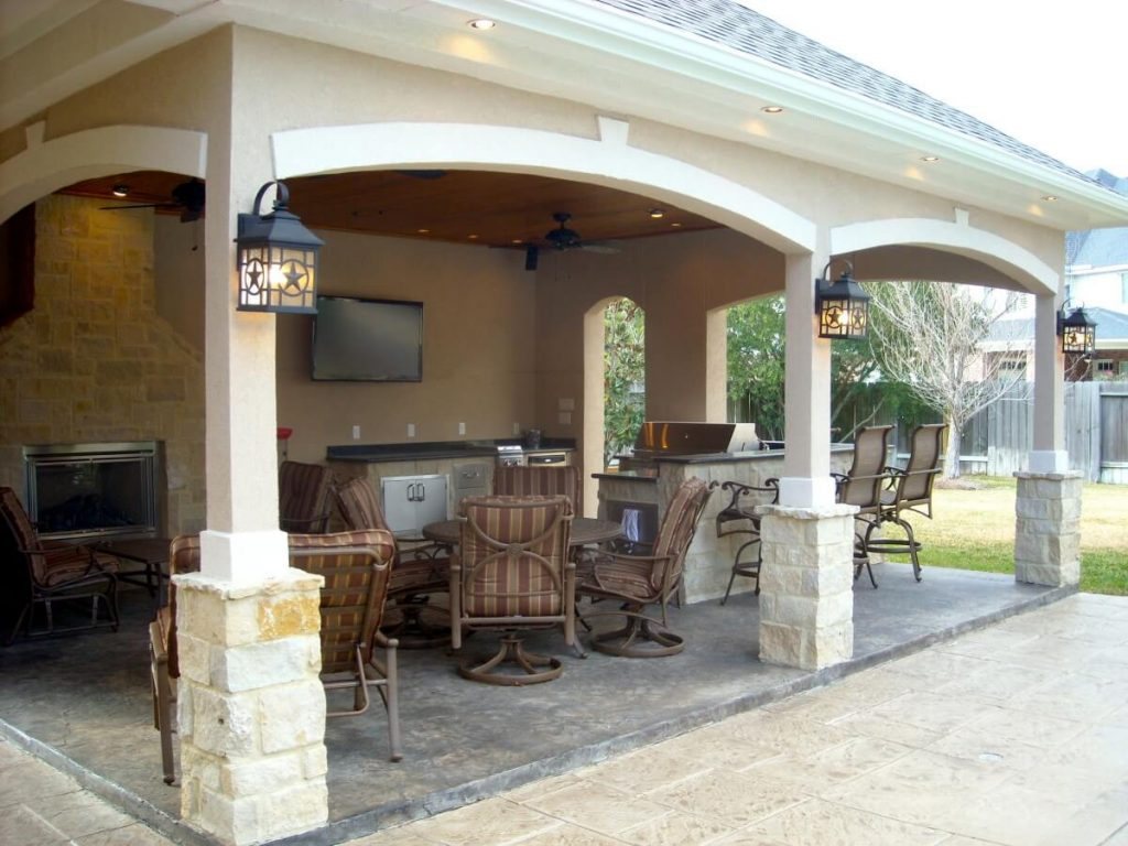 Pool House With Outdoor Kitchen Fireplace In Cypress Texas