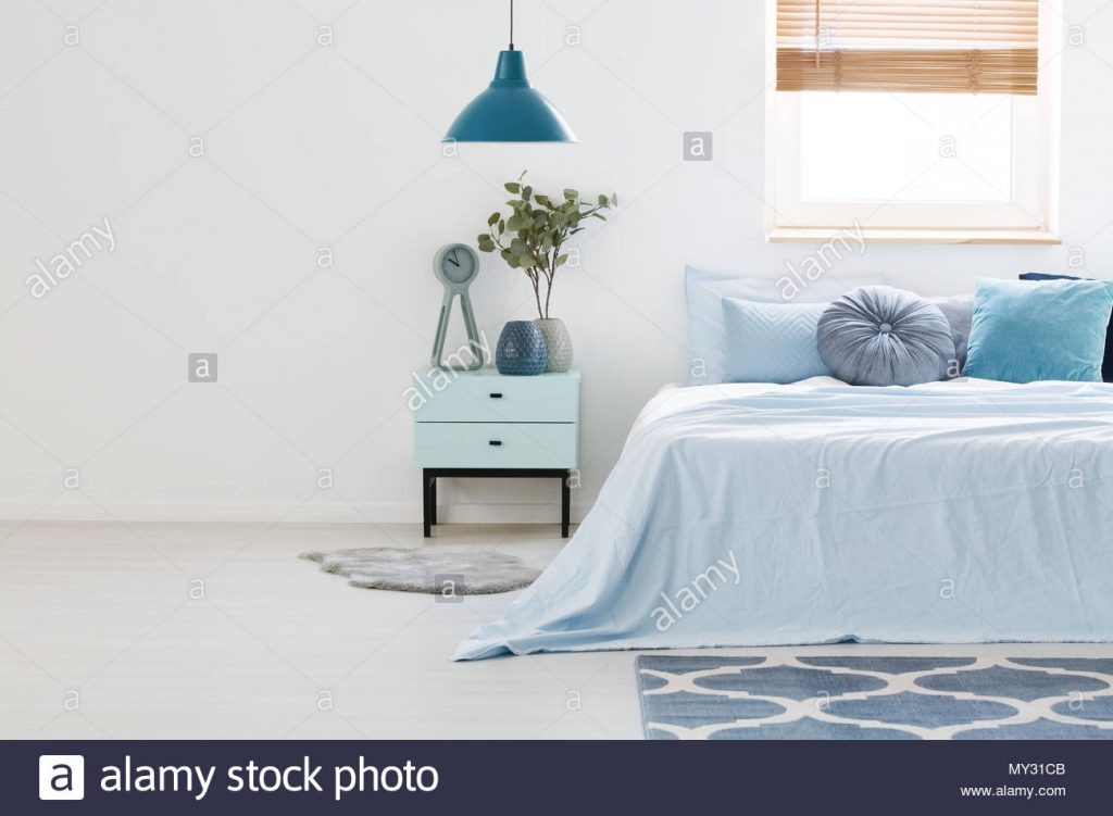 Real Photo Of A Blue And White Bedroom Interior With Wooden