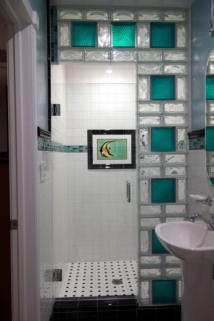 Small Colored Glass Block Shower Wall With A Finished Door And Edges