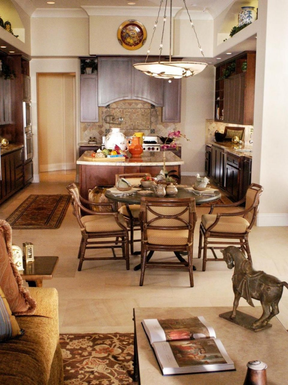 This Open Concept Great Room Encompasses A Dining Table And Tuscan