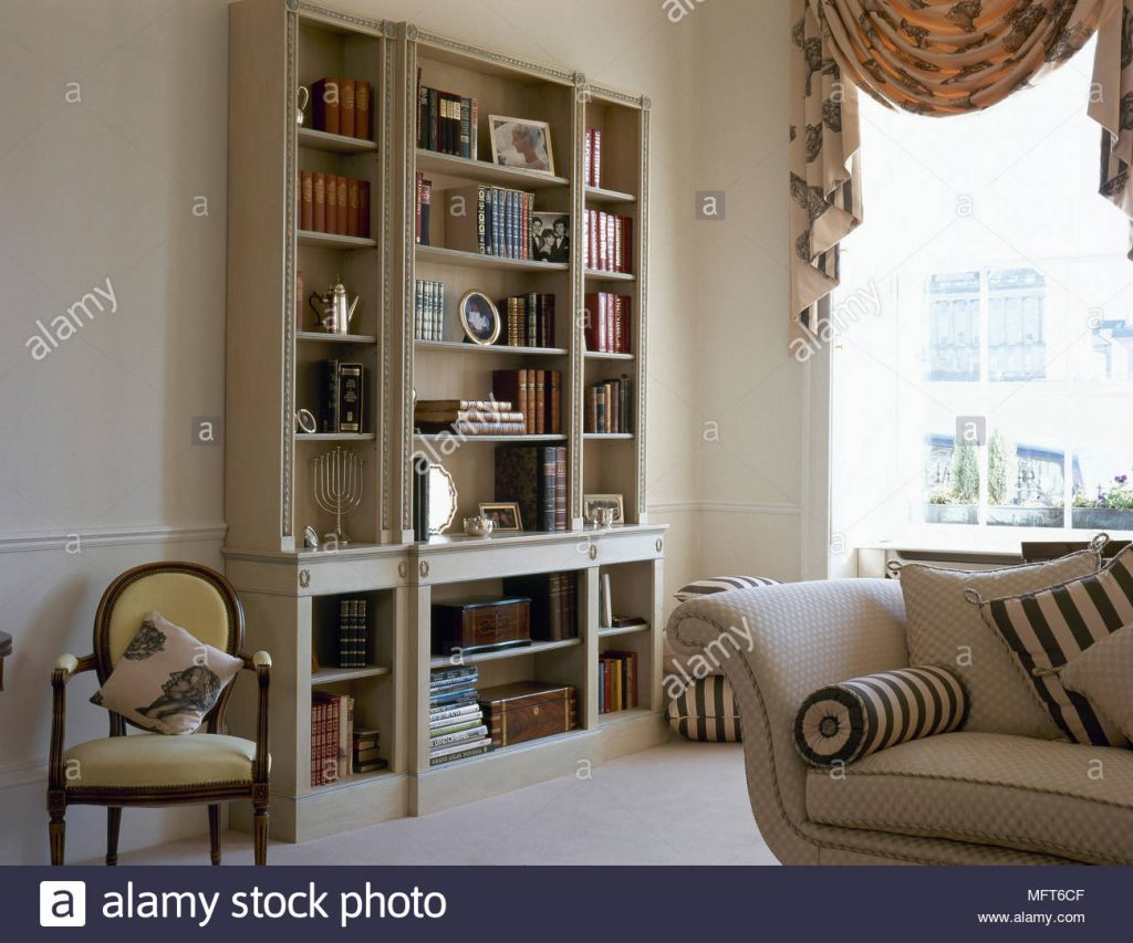 Traditional Sitting Room With A Bookshelf Upholstered Sofa And A
