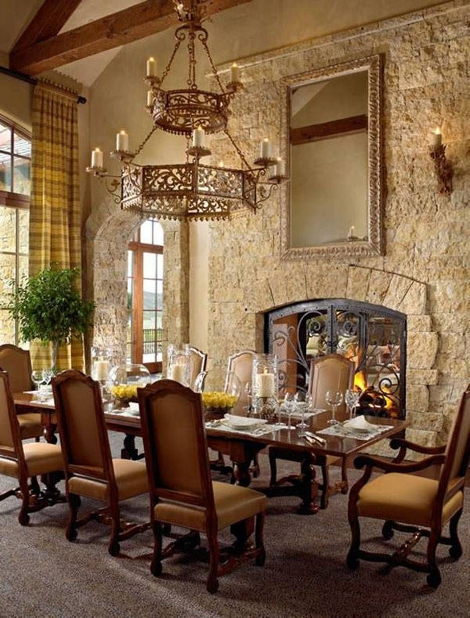 Tuscan Style Dining Room With Stacked Stone Fireplace And Sconces