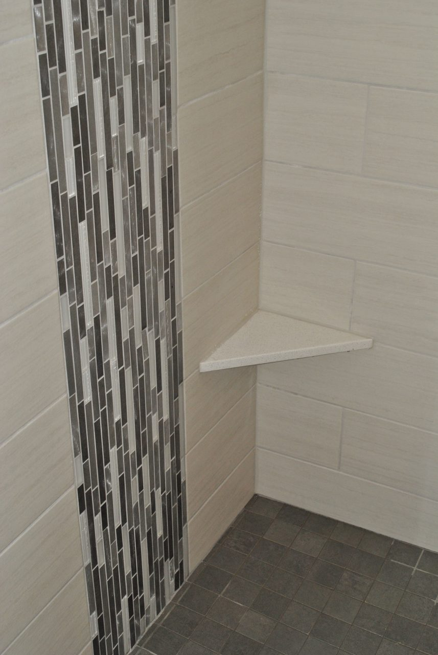 Vertical Glass Tile Waterfall Feature With Shaving Ledge Showers