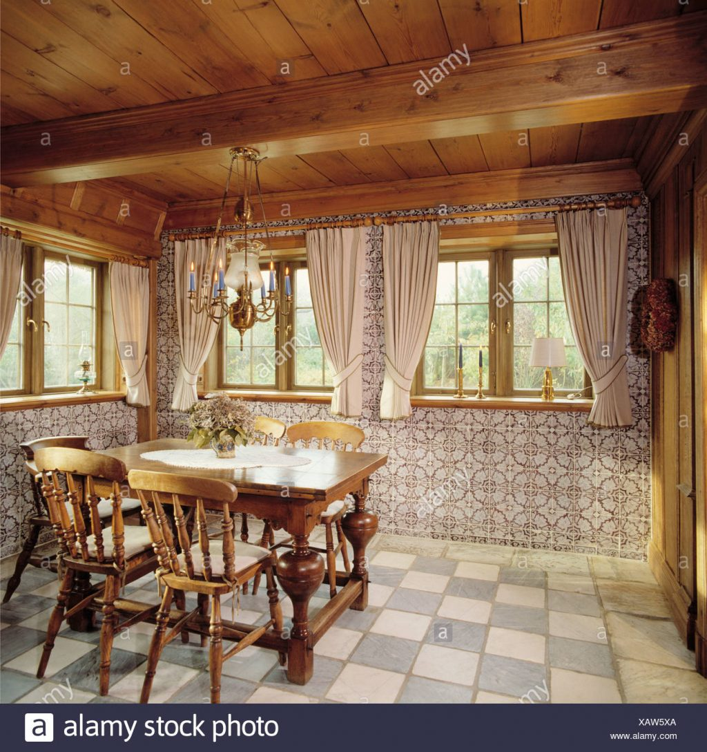 Wooden Chairs And Table In Country Dining Room With Beamed Wooden