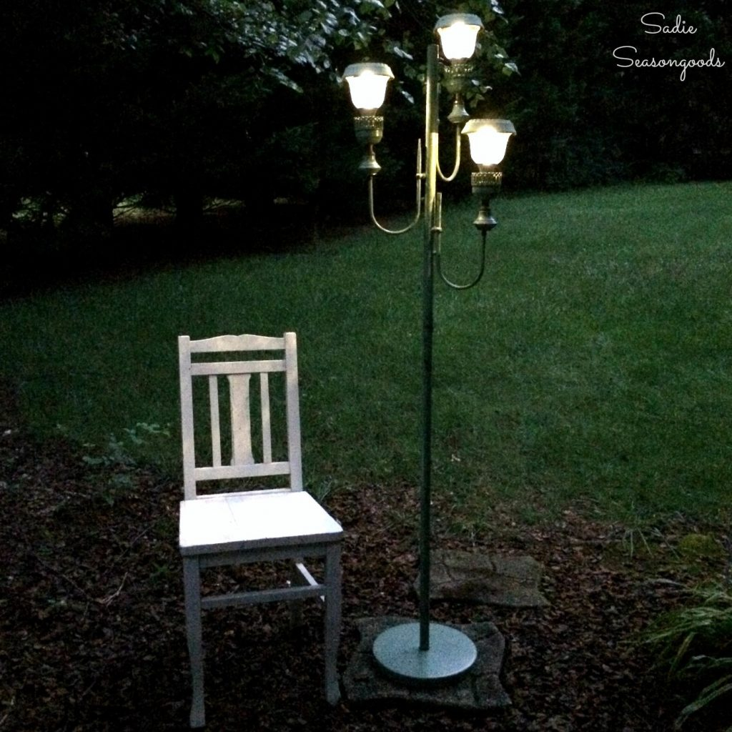 Backyard Decor With An Antique Floor Lamp And Small Solar Lights