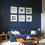 Dark Blue Living Room Decorating Idea With White Cushion On Blue