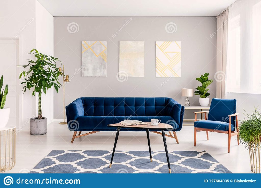 Elegant Living Room Interior With A Set Of Dark Blue Sofa And