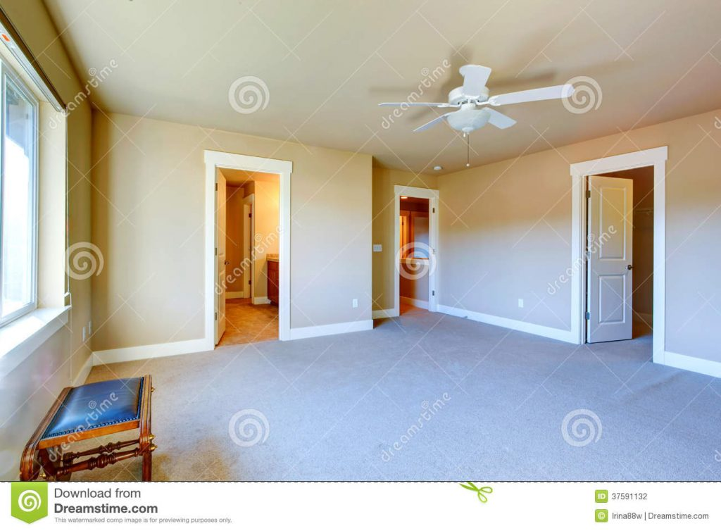 Empty Master Bedroom With Walk In Closet And Bathroom Stock Photo