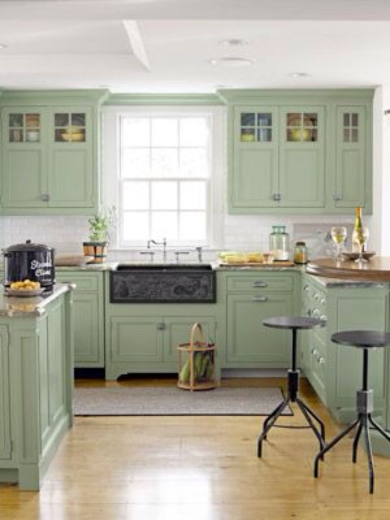Farmhouse Style Kitchen With Sea Foam Green Cabinets And Black