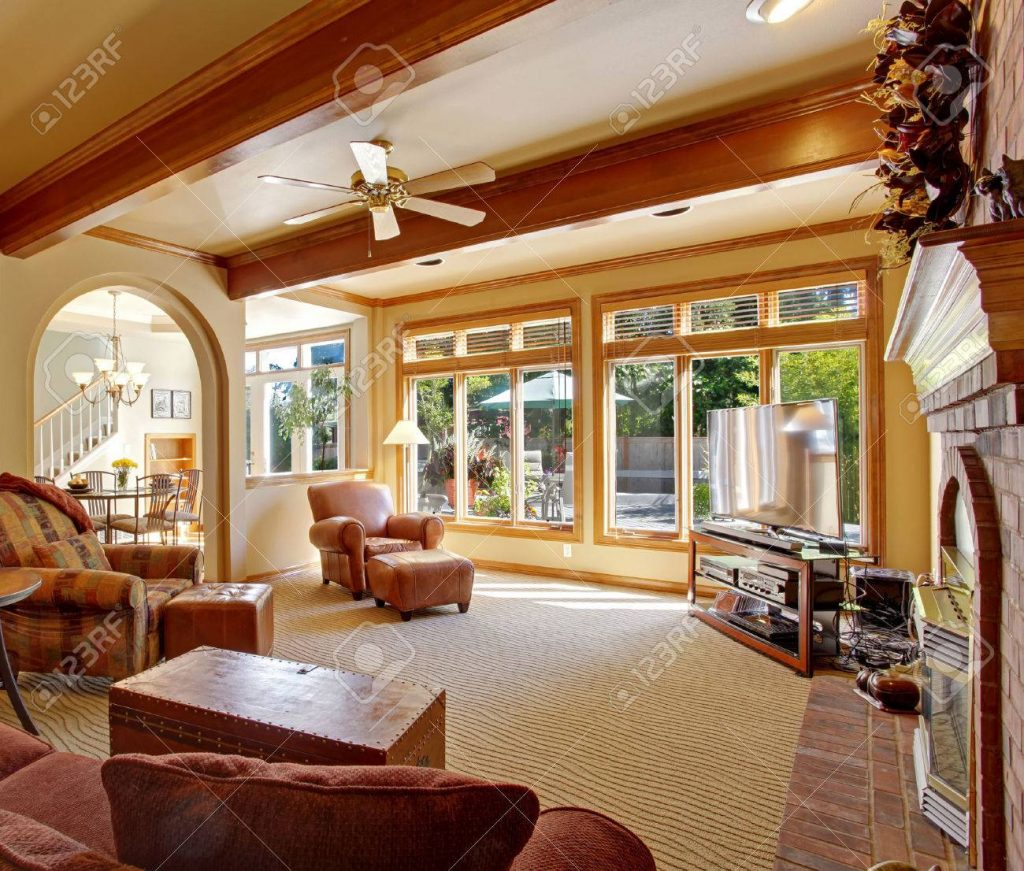 Living Room In Soft Ivory With Ceiling Beams Leather Chair Stock