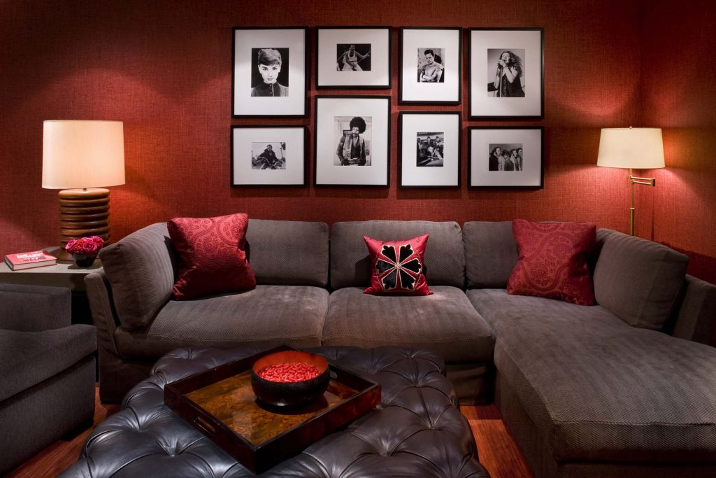 Modern Retro Style Small Living Room With Many Old Photos And Red
