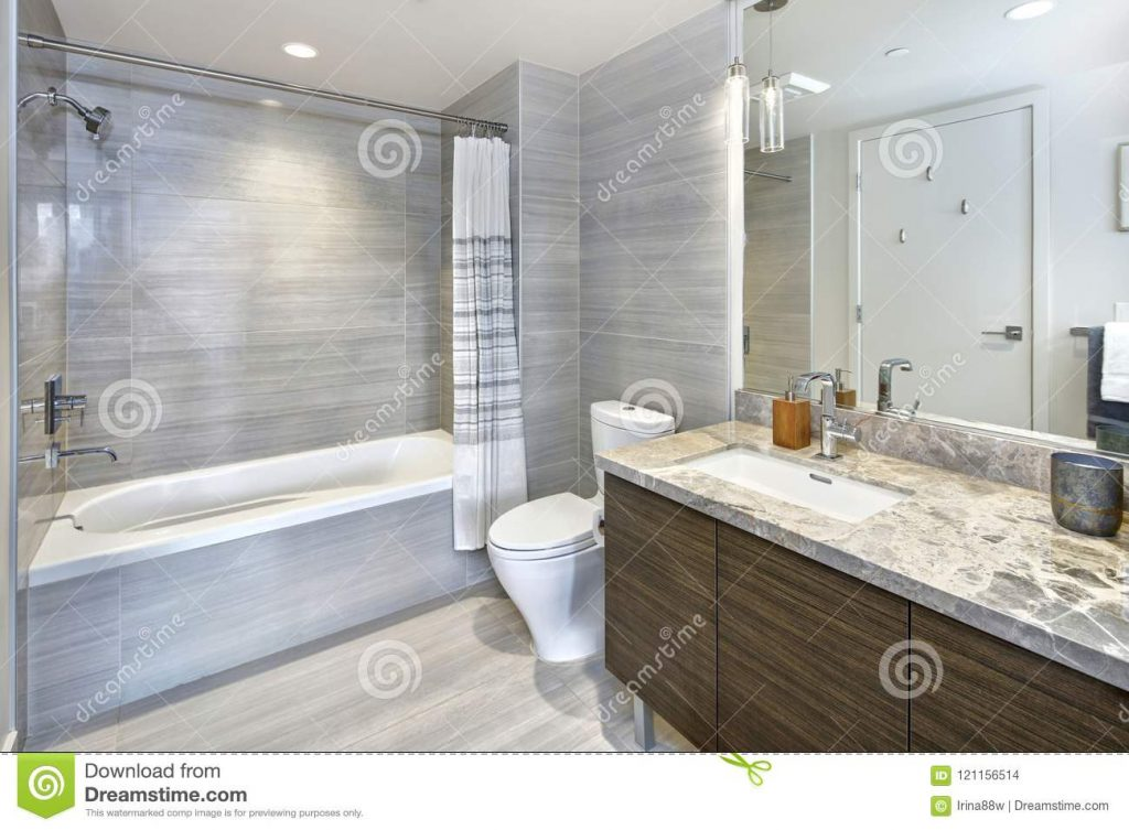 Modern Stylish Condo Bathroom Design With Gray Tiling Stock Photo
