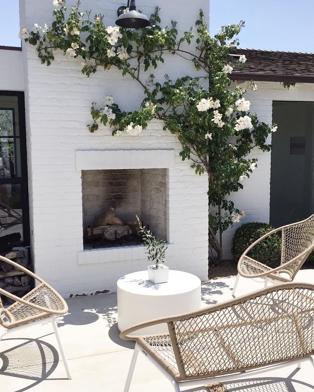 Outdoor Fireplace With White Painted Bricks Love The Boho Accents