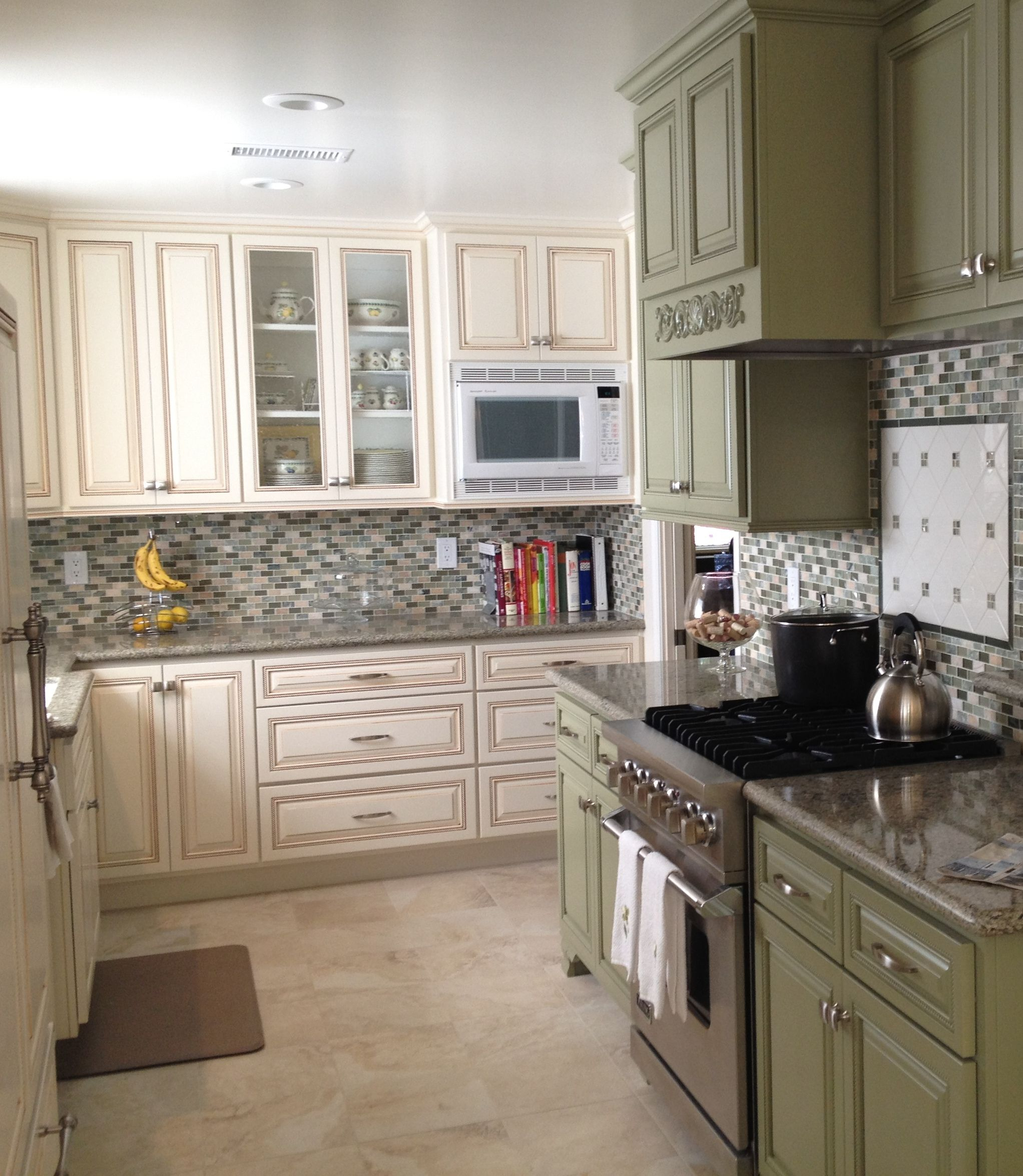 Pearl White Cabinets With Carmel Glaze Seafoam Green On Range Wall