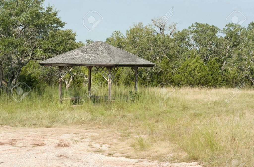 Rustic Gazebo In Tall Grass Near The Shore Stock Photo Picture And