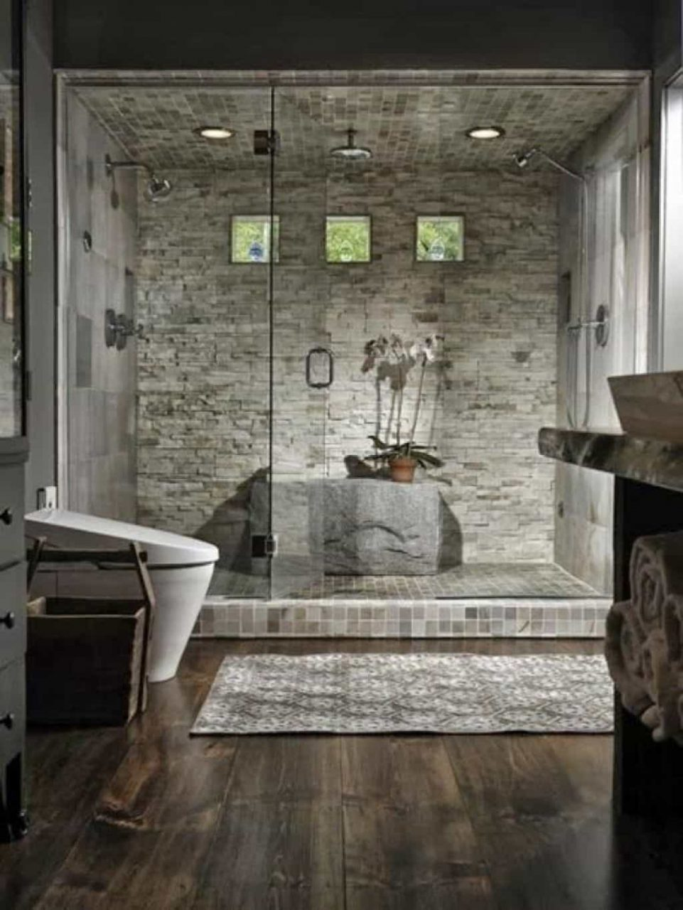 Rustic Modern Bathroom With Stone Wall Tiles And Laminate Wood