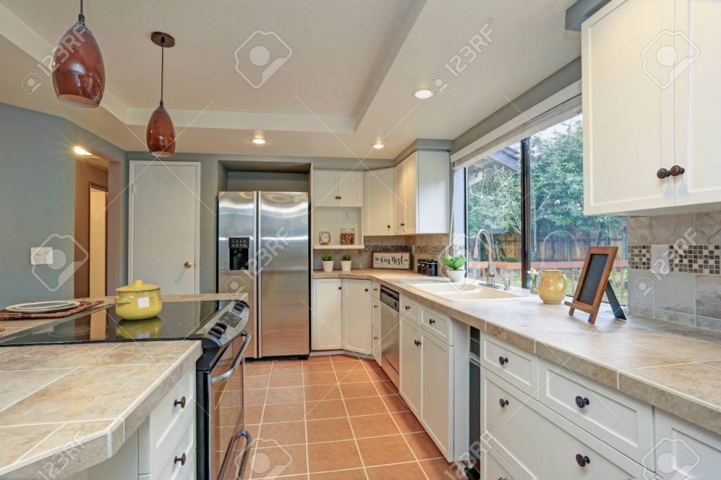 Second Floor Kitchen Boasts Tray Ceiling Island And White Shaker