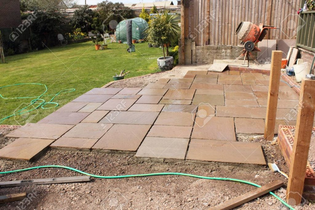 The Construction And Building Of A Natural Stone Patio In An Stock