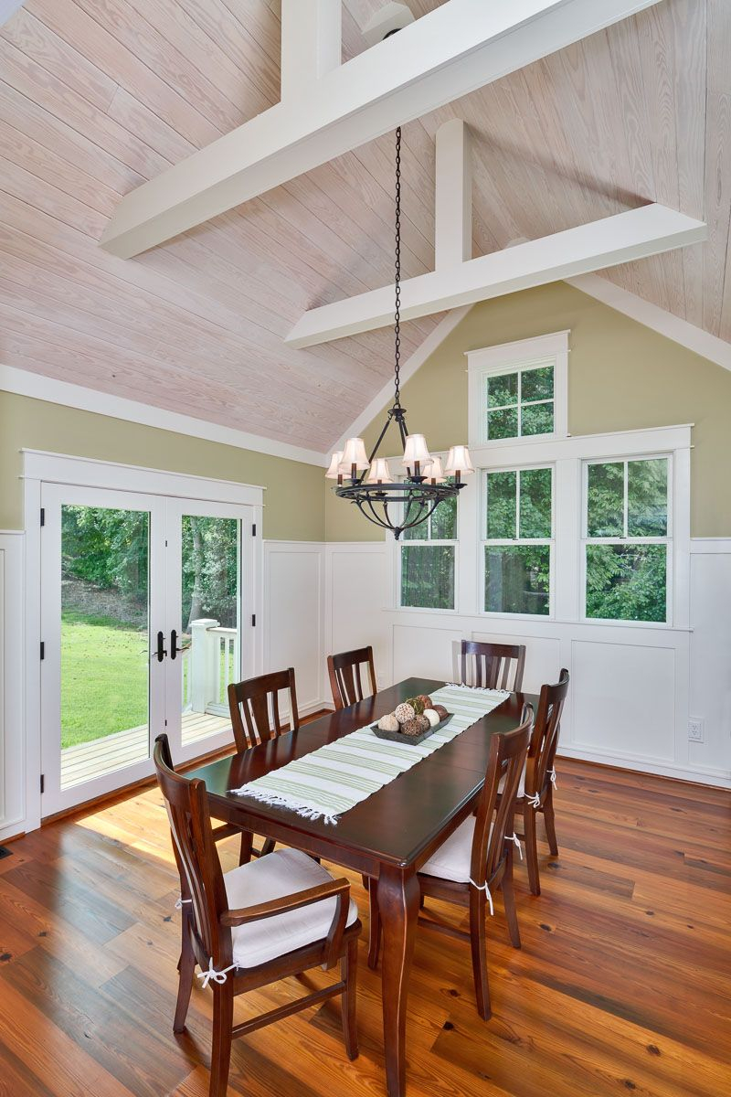 This Dining Room Features A Vaulted Whitewashed Tongue And Groove