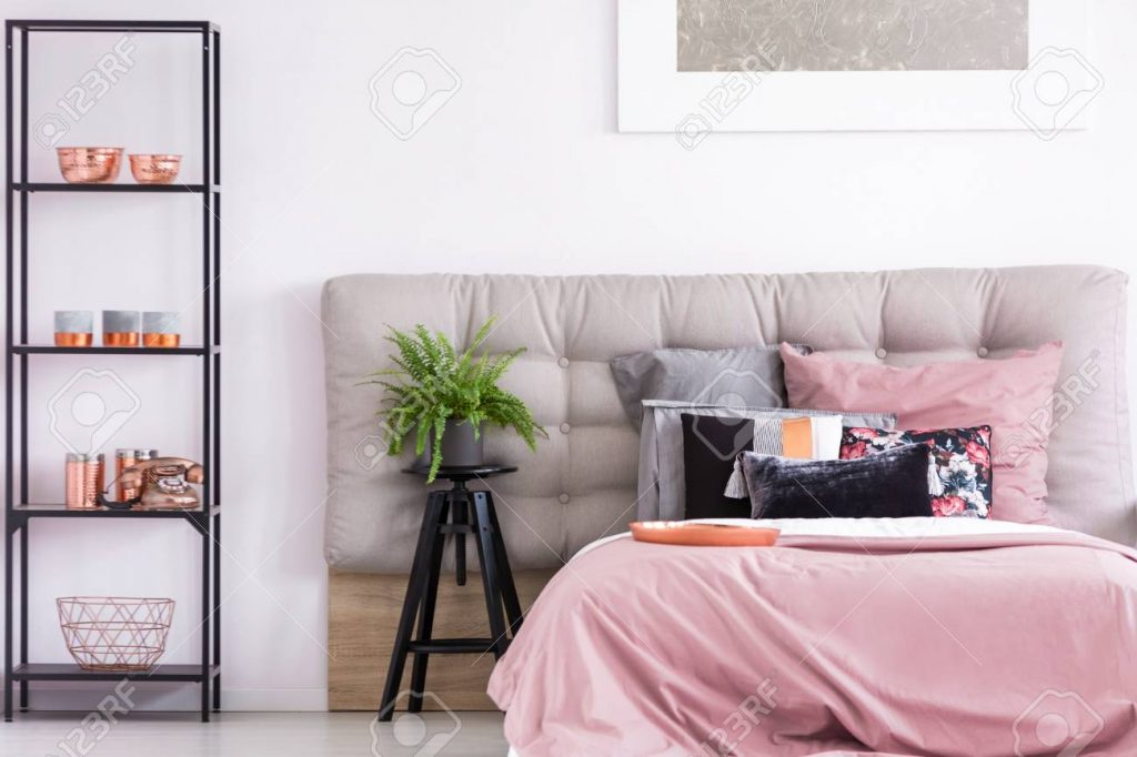 Trendy Interior Of Cozy Bedroom With Copper Accessories On Black