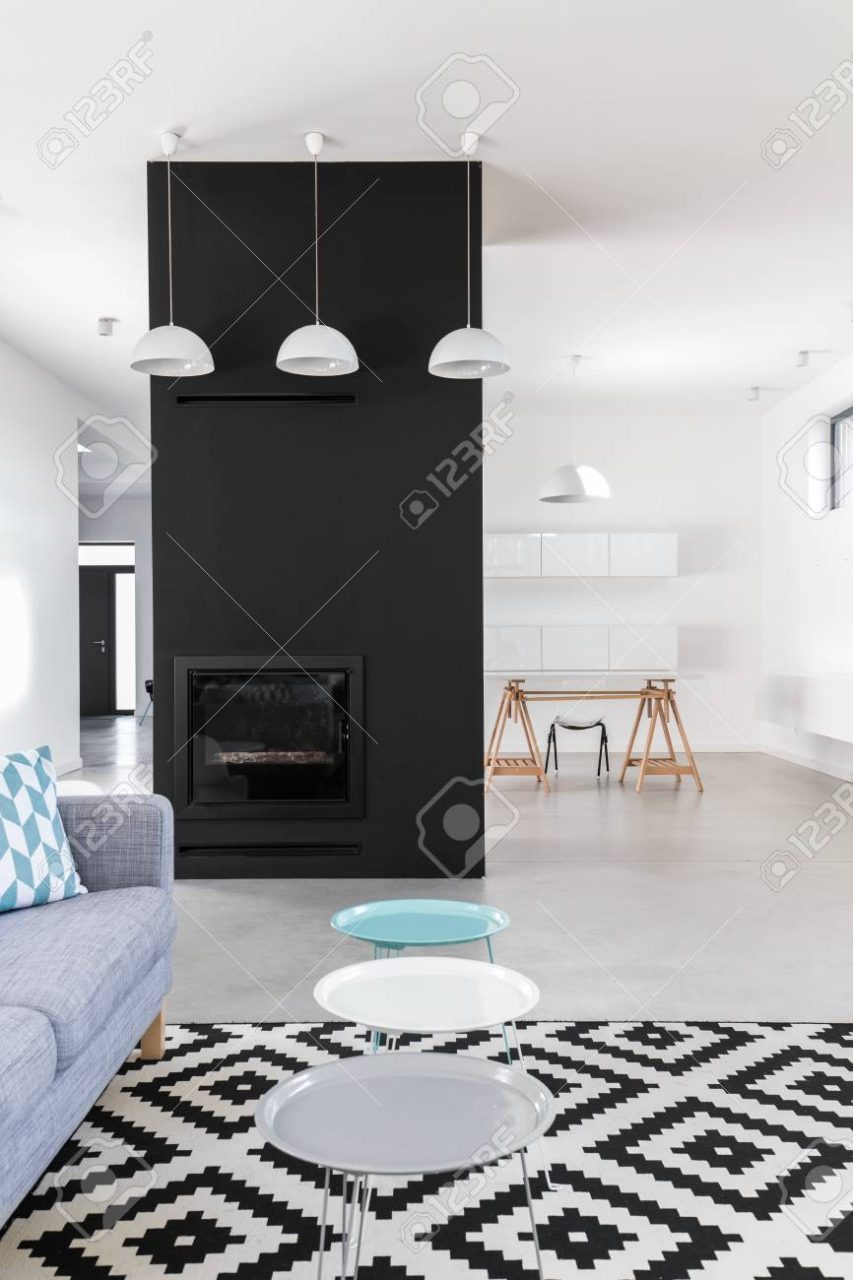 Up To Date Minimalist Design Of Living Room With Black Fireplace