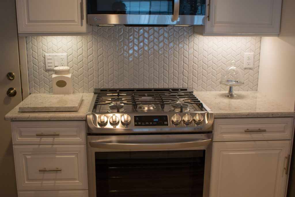 Valley White Granite With White Cabinets And A Gorgeous Patterned