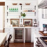 White Kitchen With Wood Floor Board Walls And Open Shelves On