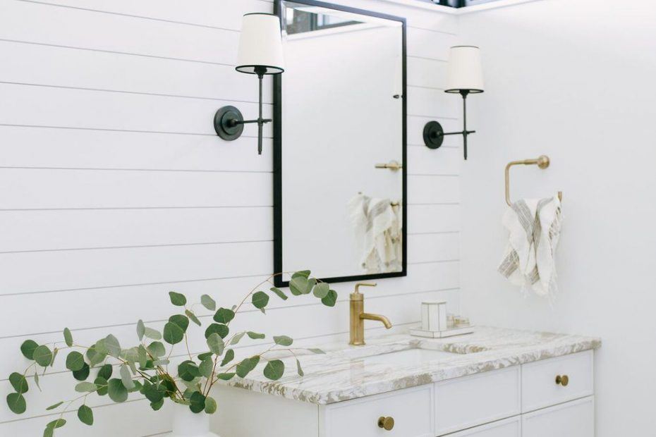 Bathroom Design Featuring White And Tan Marble And Shiplap Walls