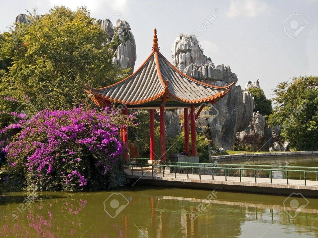 Chinese Gazebo Located In A Beautiful Garden On The Banks Of Stock
