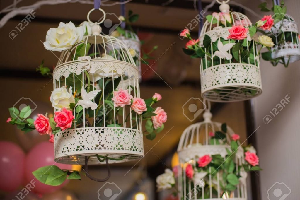 Floral Arrangement Of Flowers Bird Cage With Flowers Stock Photo