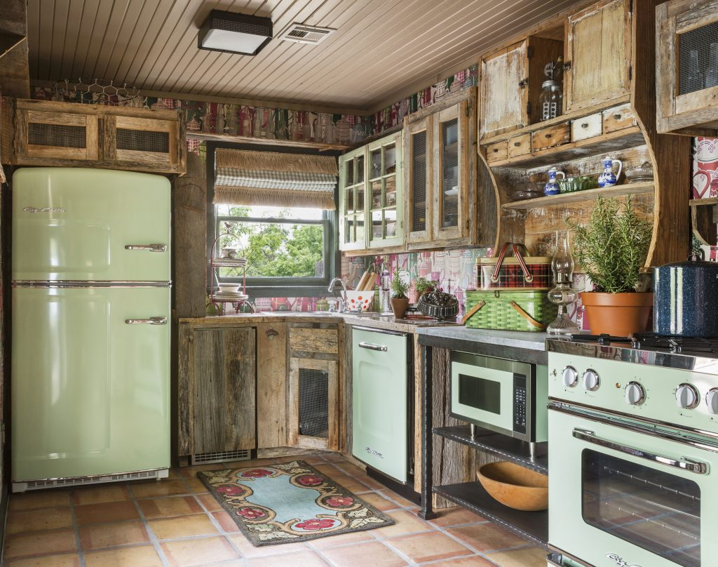 Guest Cottage Kitchen With Mismatched Cabinets And Vintage Inspired