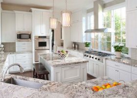 Giallo Ornamental Granite with White Cabinets