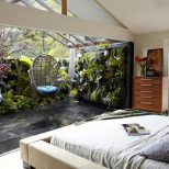 Indoor Outdoor Master Bedroom With Hanging Chairs In This Home In