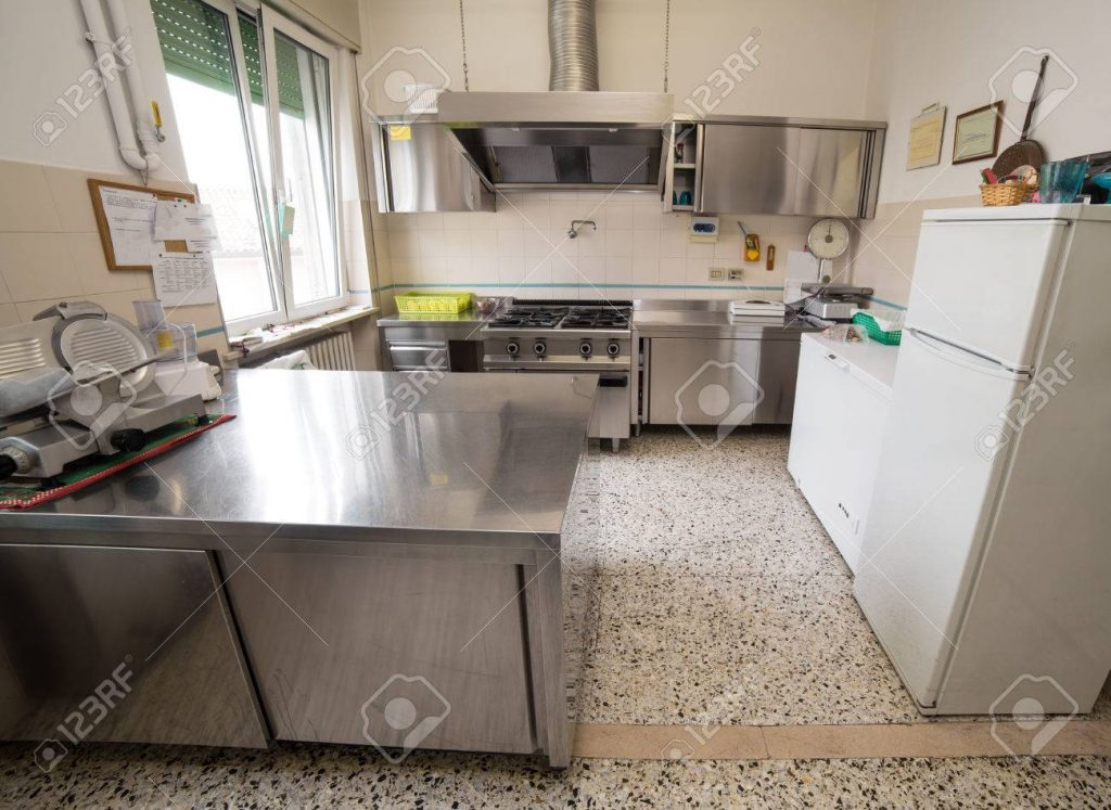 Kitchen Stainless Steel Industry With Large Gas Stove And An Stock