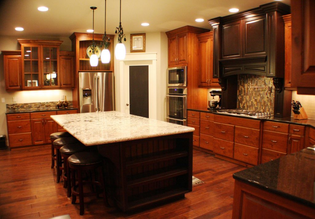 Large Brown Wooden Cherry Kitchen Cabinet With Black Countertop And