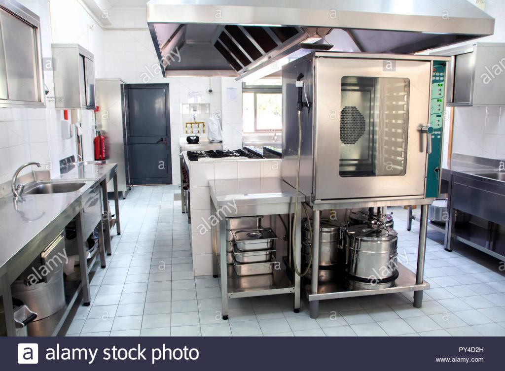 Large Industrial Kitchen Made With Stainless Steel Stock Photo