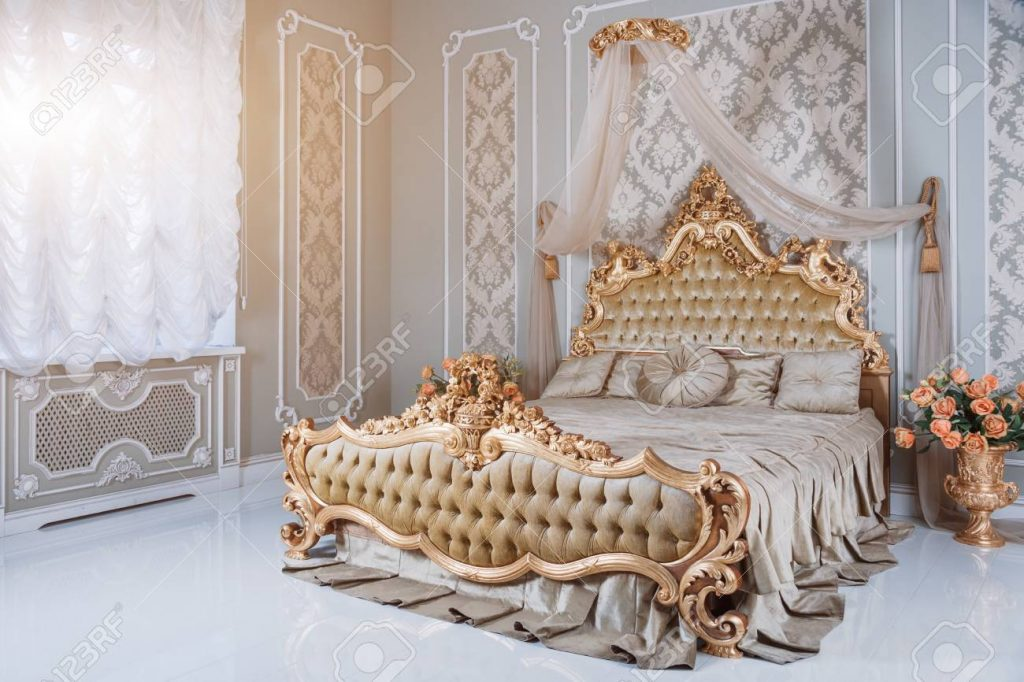Luxury Bedroom In Light Colors With Golden Furniture Details
