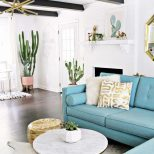 Midcentury Modern Living Room With Black Ceiling Beams A Gold