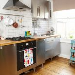 Modern Kitchen With Stainless Steel Units And Wooden Worktops