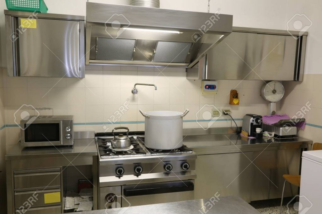 Stainless Steel Furniture Of A Large Industrial Kitchen With Stock