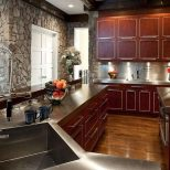 Stylish Cherry Wood Cupboards Installed In Contemporary Kitchen With