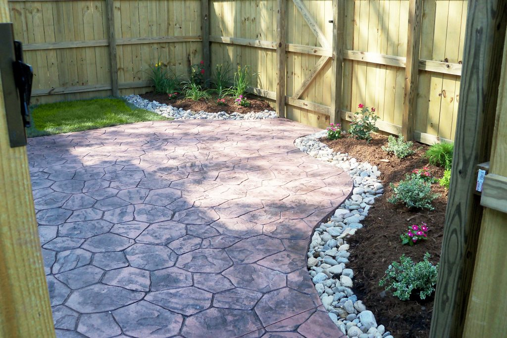 Townhouse Backyard With Stamped Concrete Patio And Simple