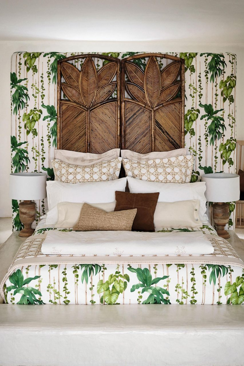 Tropical Palm Themed Bedroom With Matching Beddingwallpaper And A