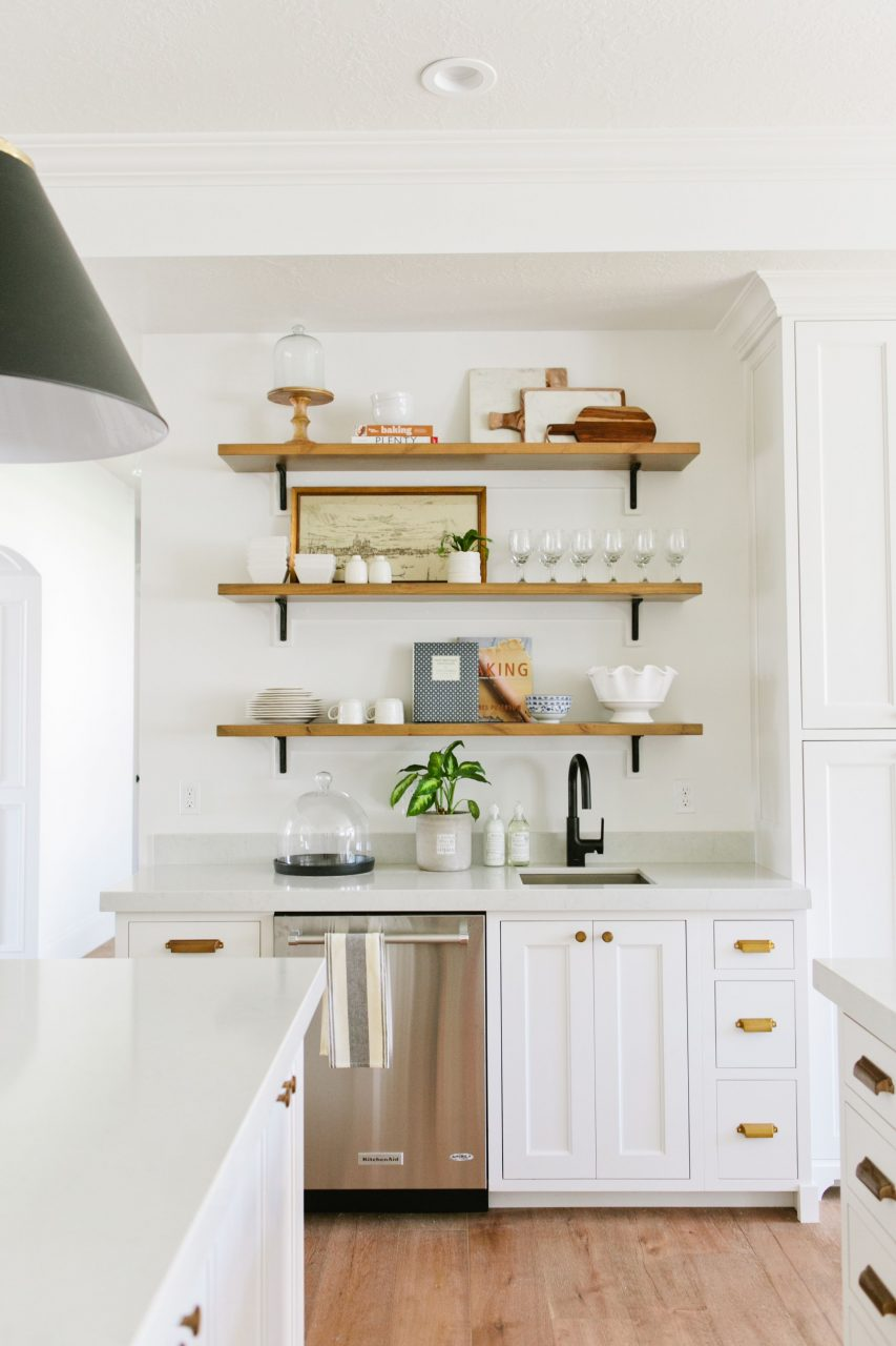 White Kitchen Cabinets Brass Pulls Floating Wood Shelves