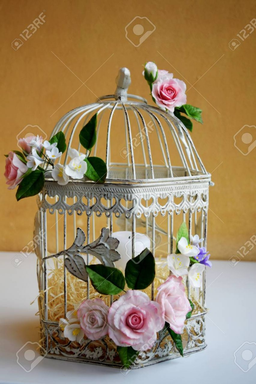 White Vintage Decorative Bird Cage With Beautiful Flowers Stock