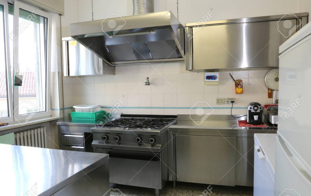 Wide Industrial Kitchen With Stainless Steel Cookers Stock Photo