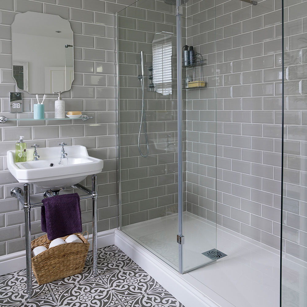 Bathroom With Roll Top Bath And Patterned Floor Tiles