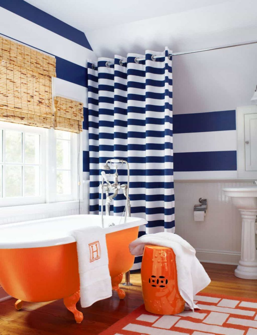 Bathroom With Stripes Walls And Shower Curtain Also Using Orange